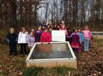 First Grade students plant Cold Frame Veggies